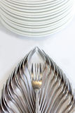Decorative fork and ceramic dish on white tablecloth, table setting for a party. Royalty Free Stock Photos