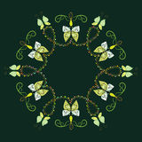 Decorative frame from abstract butterflies. In a circle on a dark green background Royalty Free Stock Image