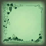 Decorative frame formed by bunch of grapes, vines, leaves, vignettes and basket with grapes. Royalty Free Stock Photos