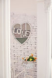Decorative frame with an inscription love on a wall Royalty Free Stock Images