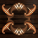 Decorative frame of light and dark bronze and copper elements on dark brown wooden surface Stock Photo