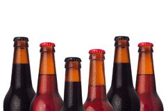 Decorative frame of set head beers bottles with porter, ale, lager beer and water drops isolated on white background. Decorative frame of set head beers bottles stock image