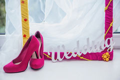 Decorative frame, women's shoes and the word Wedding Stock Photography