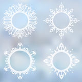 Decorative frames set. Set of four decorative snowflakes-frames  with tribal elements on the blurred background Stock Photo