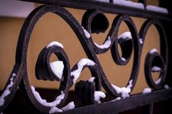Decorative framing of a metal fence with forged elements.  stock image