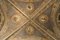 Decorative frescoes in Florence, Italy. Decorative frescoes in the old Officina Farmaceutica in Florence, Italy. View of the vault and gods, saints royalty free stock photography
