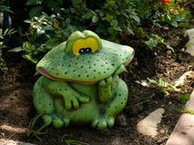 Decorative frog in the garden. Close-up stock photography
