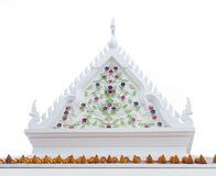 Decorative gable. Triangular decorative gable on top of the temple in buddhism monastery Stock Photos