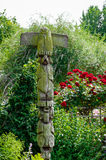 Decorative garden sculpture weathered wood outdoors in natural setting.  Royalty Free Stock Image