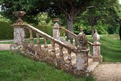 Decorative garden steps with a balustrade, urns, & globes. Royalty Free Stock Photos