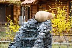 Decorative garden waterfall with stone jar Stock Image