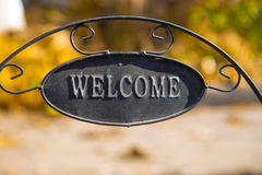 Decorative garden with Welcome Iron Signboard on Nature  background Royalty Free Stock Image
