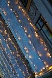 Decorative garland lights on wall.  stock photo