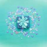 Decorative gift box with a colored background. Top view Flat Lay. Square stock photo
