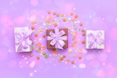 Decorative gift box with a colored background. Top view Flat Lay Stock Images
