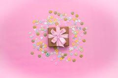Decorative gift box with a colored background. Top view Flat Lay stock photos