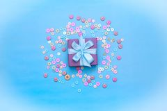 Decorative gift box with a colored background. Top view Flat Lay royalty free stock image