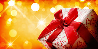 Decorative gift box with golden bokeh background close up Stock Photos