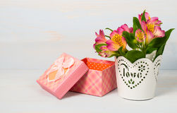 Decorative gift box and pot with flower Stock Images