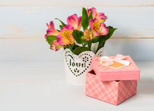 Decorative gift box and pot with flower Royalty Free Stock Photos