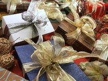 Decorative gifts. Different beautifully wrapped decorative gifts and presents with bows royalty free stock photo
