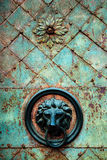 Decorative gilded lion head door knob and knocker Stock Photography