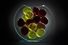 Decorative glass. Glass vase with colored transparent objects Royalty Free Stock Photography
