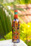 Indian floral pattern. Decorative glass bottle is painted and decorated with rhinestones Stock Photography