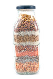 Decorative glass bottle with seeds Royalty Free Stock Photos