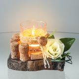 Decorative Glass Candle Holder  on a Piece of Wood. Centerpiece on the table Stock Images