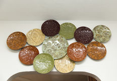 Decorative Glass Plates. Decorative and colorful glass plates on a wall inside a home stock photo