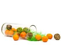 Decorative glass vase with mandarines Royalty Free Stock Photo