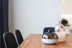 Decorative glass vases on wooden table in the kitchen. stock images