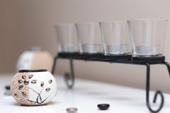 Decorative glasses on a black stand Royalty Free Stock Photo
