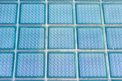 Decorative and glossy glass block window in blue as a texture or for background. Geometric background. Royalty Free Stock Image