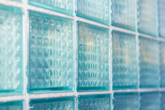 Decorative and glossy glass block window in blue as a texture or for background. Geometric background. Stock Image