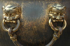 Decorative gold handles. Decorative gold handle in the shape of fantasy or mythical figures Royalty Free Stock Photography