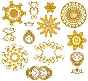 Decorative Gold Web Icons. A collection of 12 decorative digital art design elements, buttons, accents and icons with swirl, circle, flower, jewelry and star Royalty Free Stock Photo