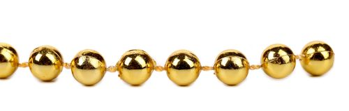 Decorative golden beads. Royalty Free Stock Photo