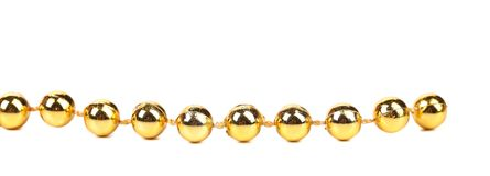 Decorative golden beads. Horisontal. Isolated on a white background Stock Photo