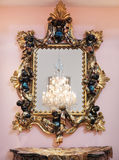 Decorative golden mirror frame Stock Photos