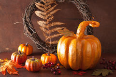 Decorative golden papier-mache pumpkin and autumn leaves for hal Royalty Free Stock Photography