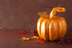 Decorative golden papier-mache pumpkin and autumn leaves for hal Royalty Free Stock Photos