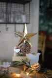 Decorative golden Xmas star. Closeup of a decorative golden Christmas star on a table in a home Royalty Free Stock Photo