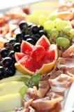 Decorative grapefruit garnish on a meat platter Stock Images