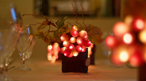 Decorative Grapes. Decorative illuminated Grapes Cluster in red and white colors on the table Stock Photos