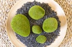 Decorative grasses pebbles on bamboo Stock Image