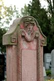 Decorative gravestone. Details of a decorative gravestone or headstone with carvings Stock Image