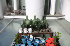 Decorative green bottles. Decorative bottles of green glass and ceramic pots for plants Royalty Free Stock Photo