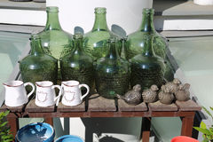 Decorative green bottles. Decorative bottles of green glass and ceramic pots for plants Royalty Free Stock Photos